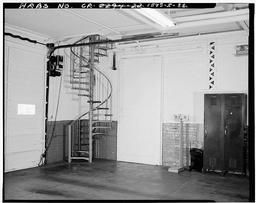Photograph Of First Floor Showing Spiral Stair From Engine Room To Second Floor Dormitory.