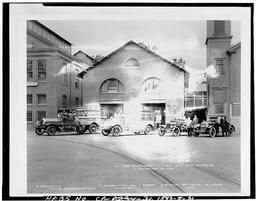 Photocopy Of Photograph Showing Period Fire Engine And Personnel In Front Of Building 99