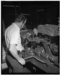 View #6, Of Views Showing Workers In Various Stages Of Assembling Wood Block Belts And Transmission Systems