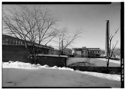 Weave Shed, View Of Rear Of Building From Adjacent Property, Stone Mill And Boiler Plant Smokestack At Background Right