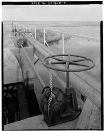View Of Hand-operated Radial Gate Hoist At Outlet Works Of Dam 326, Looking Northeast