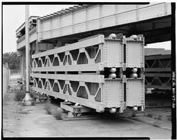 View Of Tainter Gate Bulkheads, With Bulkhead Cars And Tracks In Storage Yard, With Dan Bridge Overhead, Looking West